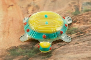 Beautiful Zuni Turtle Fetish Created by Zuni Artist Laura Quam. Signed by the Artist. Hand carved from Turquoise, Mother of Pearl, Melon Shell and Coral. 